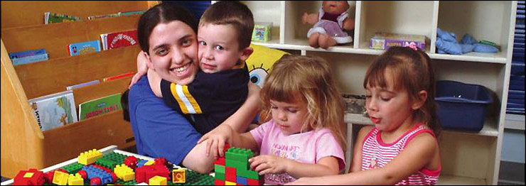 childcare worker with three children