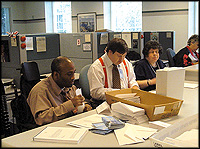 MBNA employees sorting mail